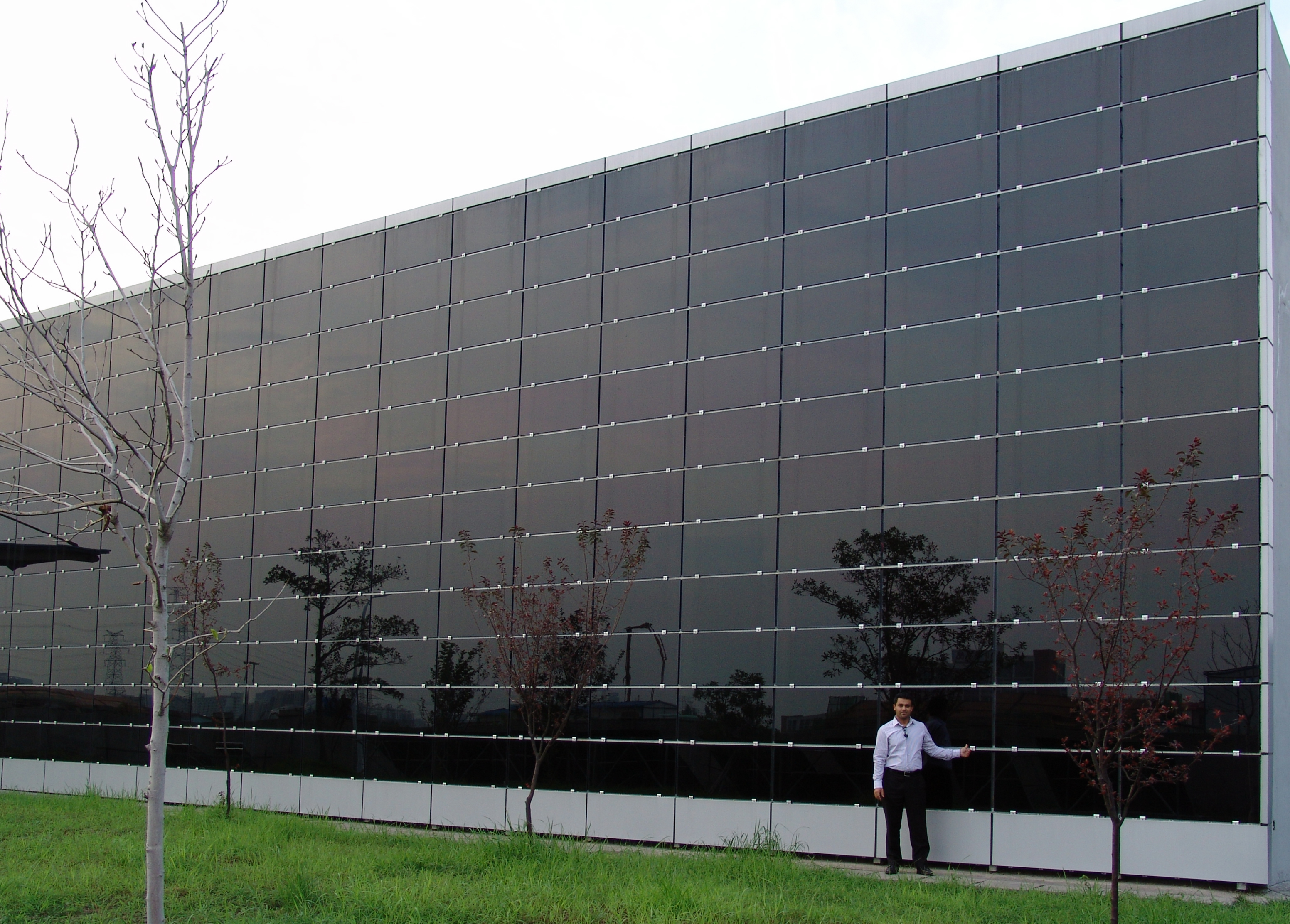 Solar Curtain on Factory Warehouse. Convert your unused wall space ...
